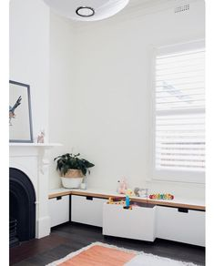 Minimalist storage, perfect for kids toys. Simple modern living. Read our post here for lots more ideas.