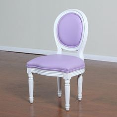 ---  - Patent leather upholstery. - Wide, extra padded seat. - Carved detail on the legs. - Great for dining or for use in a child's room. - Measures 28 inches high x 15 inches wide x 15 inches long.