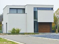 Nieuwbouw • modern • gevelpleister • plat dak • houten bekleding • Foto: www.thuisbest.be