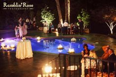 Poolside wedding reception decor by Southern Event Planners, Memphis weddings, floating candles
