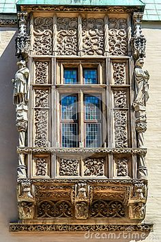 An old window is decorated stone ornaments