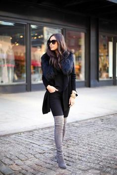 25 ways to wear fall 2015's top trend: suede - gray over the knee suede boots with black jeans and fur http://stylecaster.com/how-to-style-suede/