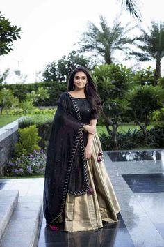 Indian actress Keerthy Suresh wears a stunning black and gold lehenga for the promotions of her upcoming tamil movie Sandaikozhi 2 . Lehenga Designs, Salwar Designs, Half Saree Designs, Kurti Designs Party Wear, Blouse Designs, Indian Designer Outfits, Indian Outfits, Designer Dresses, Designer Lehanga
