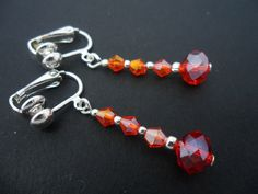 A Pair Of Dangly Red Crystal Bead Silver Plated Drop Clip On Earrings.