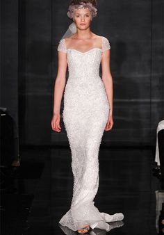 4606 by Reem Acra    Silhouette: Sheath  Neckline: Sheer, Sweetheart  Waist: Natural  Gown Length: Floor  Train Style: Attached  Train Length: Sweep  Sleeve Style: Cap, Fitted, Sheer  Fabric: Tulle  Embellishments: Beading, Embroidery  Color: White, Ivory