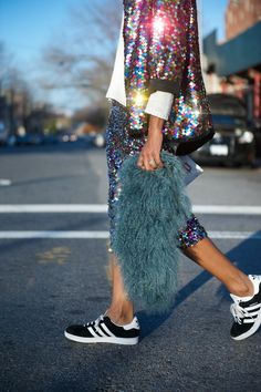 Dress down your sequins for day by mix and match with trainers