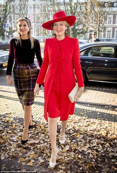 Queen Máxima of the Netherlands, left, and Queen Mathilde of Belgium, right, were both loo...