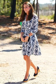 """April 17, 2014-The Duchess of Cambridge wore a Diane von Furstenberg """"Patrice"""" cotton wrap dress with 3/4 sleeves, Stuart Welzman cork wedges, Cartier watch and sapphire and diamond earrings."""