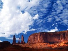 one of many volcanic diatremes found in Navajo country and upon the lowest heights of this eroded volcanic breccia lies the tall white shape of a Native American tipi. Old West, Monument Valley, Native American, Arizona, Scenery, Stock Photos, Navajo, Nature, Spanish