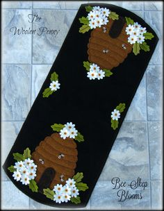 Kit contains all 100% wool fabrics to complete one ~Bee Skep Blooms~ table runner measuring 10 inches wide by 24 inches long. All fabrics are 100% hand dyed wool and 100 % mill dyed wool. Black background and backing fabric included. **Pattern included**