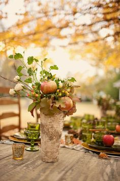 Decor for a fall table with apples and birch.