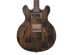 Whiskey Barrel Electric Guitar Introducing the Bourbon and Blues guitar, a revolutionary instrument that materializes the longstanding relationship of the spirits and music industry. The stunning woodgrain and history in each instrument is second to none, featuring a solid ash core capped with reclaimed quarter sawn American White Oak sourced from genuine whiskey barrels.