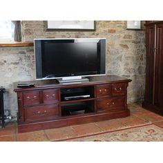 A large plasma television can dominate a room and unwittingly become the focal point of your lounge. Well with this solid mahogany widescreen television cabinet, all eyes will be drawn to the cabinet and not your television Television Cabinet, Television Stands, Mahogany Furniture, Home Curtains, Led Televisions, Large Drawers, Online Furniture Stores, Furniture Collection, Open Shelving