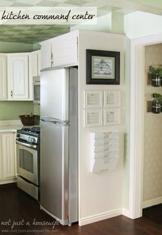 DIY:  Kitchen Command Center - basic DIY shows how she added a panel beside her refrigerator - the panel holds the necessities needed for the command center.