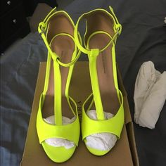 ZARA collection neon yellow T-Strap shoes Only tried on at the store, thought I could use with insole. However still fits too big as I am a 7.5. These are a Size 8 in original box. Zara Shoes Heels