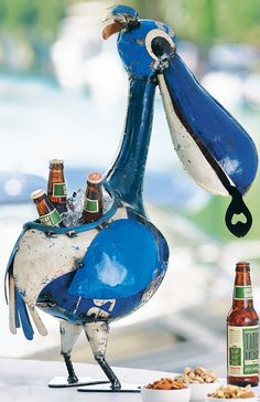 This upcycled delight will keep your drinks safely stowed and chilled. The Pelican Beverage Tub is handmade from recycled 44-gallon metal drums, still painted an iconic bright blue. He can hold up to six 12-ounce bottles and ice, and is ready to assist with a fish bottle opener in his mouth.