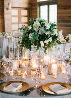 Rustic hydrangea, peony and tulip wedding centerpiece: http://www.stylemepretty.com/florida-weddings/santa-rosa-beach/2016/10/10/rustic-elegant-florida-coast-wedding/ Photography: Harwell - http://www.harwellphotography.com/