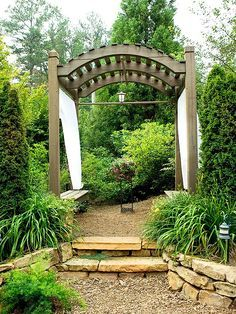 Beautiful arbor with seating and drapes. #arbors homechanneltv.com