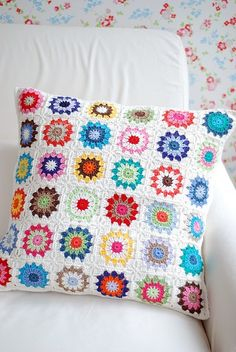 I love the bright colored granny square accessories for the bedroom