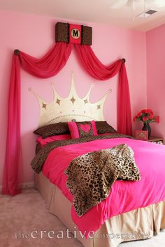 Love the swag fabric, the initial (maybe more of feminine font), also love the crown painted on the wall. Perfect package for a princess room.