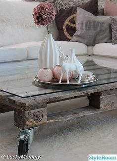Unusual and cool idea for a coffeetable, plus the trinkets on it are too cute