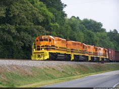 Pic #10   Description:  Columbus & Chattahoochee RR SD40-2 3348 leads their Mahrt turn south along Brickyard Rd in Phenix City on Day 1 of operations.   Photo Date:  7/1/2012  Location:  Phenix City, AL   Author:  Ken Roble  Categories:  Winter  Locomotives:  CCHT 3348(SD40-2)