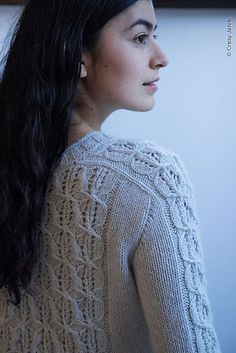 Frostpane is a seamless, top down pullover with lace and cable pattern panels at the front, back and in the centre of the sleeves.