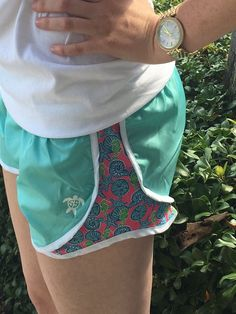 Aqua Simply Southern jogger shorts with seashell pattern down the side.