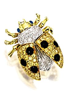 ENAMEL, DIAMOND AND GEM-SET 'LADYBIRD' BROOCH, GARAVELLI The brooch modelled as a whimsical ladybug, set with circular-cut yellow sapphires and diamonds, accented by black and blue enamel, signed Garavelli;