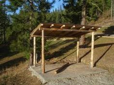 making firewood shed with logs or shed for horse feeding station...so she can be out of the sun and her feed stays dry.