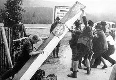 Upon the announcement of the Munich Agreement, Nazi supporters in the Sudetenland rip down border posts separating them from Germany.