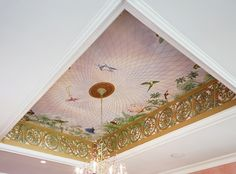 Trompe l'oeil and stenciling makes a focal point out of an otherwise ordinary ceiling...