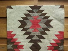 Vintage Navajo Rug. Grew up surrounded by these. They'll be forever cool.