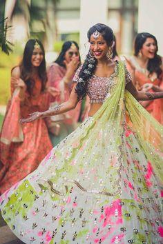Pair your subtle lehnariya lehenga with a heavy mirror work blouse and you're good to go! (C) Morvi Images; outfit by akanksha gajaria #wittyvows #mirrorworkoutfits #wedding #indianwedding #bride #weddingphotography #bridal #indianbride #weddingseason #floraljewelry #floraljewellery #haldioutfit #bridetobe #love #mehendi #mehendi #weddingdress #jewellery #weddings #photography Mirror Work Blouse, Mehendi Outfits, Lehenga Jewellery, Formal Dresses, Wedding Dresses, Wedding Season, Bridal Style, Designer Dresses, Bridesmaid