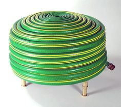 The Hose Hassock  This has become a real signature piece.  (de: garden hose, brass faucets and padding)