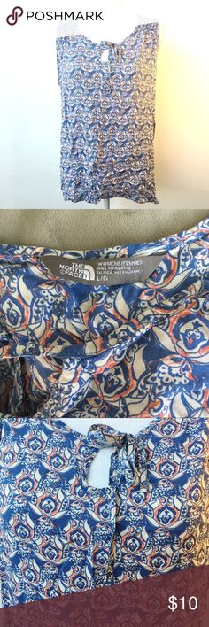 """The North Face Annabelle sleeveless top, L The North Face Annabella Sleeveless Tank Top Size L ~ 100% Viscose Blue/Coral Floral Print Ruched Shoulders, Ties at neck Preowned, no stains or tears. Great condition! Bust 40,"""" waist 40"""" (loose fit). The North Face Tops Blouses"""
