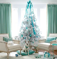 This all-white room with sea foam green accents calls for crisp, cool-hued Christmas decorations, so a flocked tree was a must.