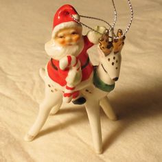 Hello, I am trying to lessen my Christmas decorations as I get older. Napco or Lefton Japan 1950s bone china ornament Santa holds a candy cane and waves to us riding a sweet gold spotted and antlered reindeer. | eBay!