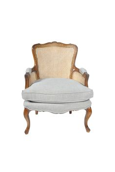 The Catherine Bergère is shown in Oak  wood with an Aged Oak finish. It has caned sides, curved Louis XV legs en cabriolet and a loose seat cushion.