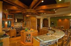 Unique and rustic kitchen with octagon shaped island fitting in the middle.2)