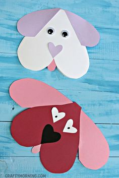 Materials Needed: Red, Pink, White, Black Construction Paper Scissors Glue Black marker Folding Card Template Start by cutting out two big red and pink hearts from construction paper. Cut the pink heart in half to make the dog's floppy ears. After that cut out a smaller black heart for the nose and two little white …