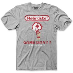Game On!   This shirt will take you back! A vintage graphic that screams Nebraska victory on game day. A distressed screen print on a soft heather cotton tee  •Red Zone Exclusive Brand  •100% soft cotton  •Distressed screen print  •This item runs small and is athletic fit. $19.99  # Huskers #Nebraska Red Zone