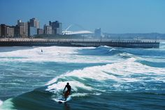 City Surfing at Durban, South Africa. Photos and video interview with local Durban Surfers, where the central business district meets the beach! Africa Art, Out Of Africa, Africa Drawing, Durban South Africa, Africa People, Kwazulu Natal, Holiday Places, Surf Trip, Beaches In The World