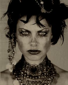 I love the pieces of jewelry in this it makes the picture.  It is very interesting how fair makeup can go.