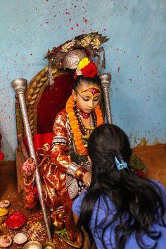 Asia: A Kumari giving a blessing to a Newari lady, Nepal