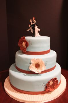 Elegant and simple. A 3 tier wedding cake covered in Tiffany blue fondant and brown fondant ribbon. Not sure who it was made by, either way I think it's lovely.