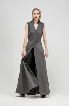 Stand up collar. Deep v neckline. Sleeveless. Criss cross bodice snaps at waistline. Dramatic skirt. Side inseam pockets. Option to wear open.  - See more at: http://www.sistersoftheblackmoon.com/sotbm/products-page/shop-sotbm/ash-vest/#sthash.m4bETbh3.dpuf