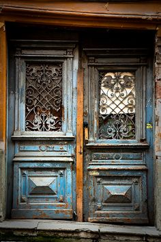 crumbling door by flamed, via Flickr