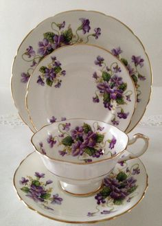 """Vintage Paragon """"Valentine"""" china tea cup, saucer and plate made in England.  A white ground with purple violets on the cup, saucer and plates. A beautiful"""