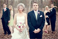 I love the placement and posing of the wedding party in the back...helps add a bit of drama to the image!